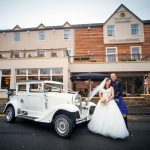 Badsworth with Bridal Couple outside the Busby Hotel